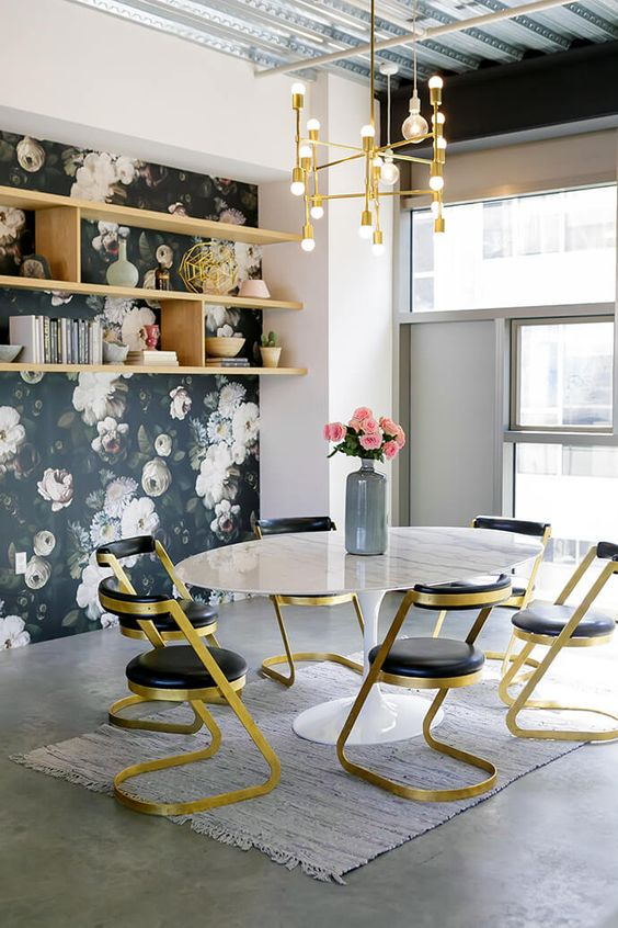 gold and black chairs look glam and echo with a gold chandelier