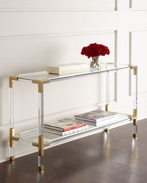 lucite and brass console looks fashionable and accomodates enough things