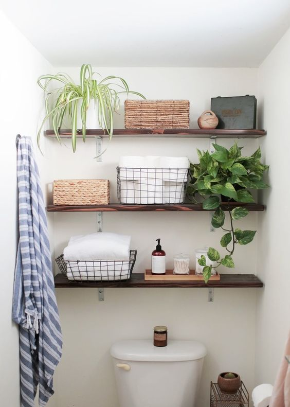 thin dark stained wooden floating shelves for storing bathroom things