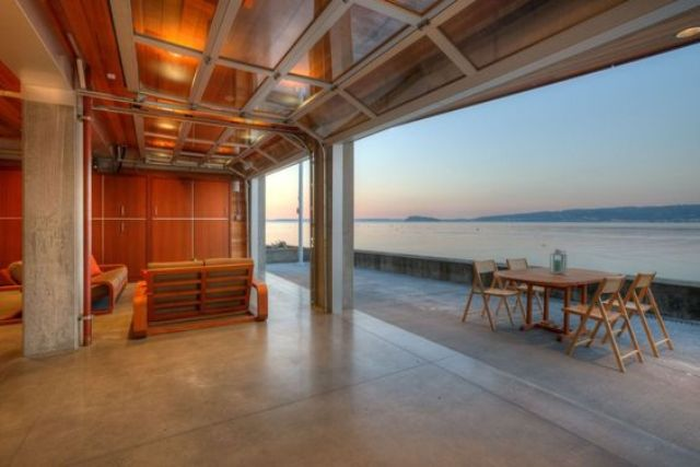 when you have such ocean views, you need to open the space to it with garage doors