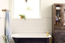 21 a black clawfoot tub and gold accents give the space an exquisite feel