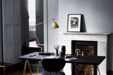 21 a brass and black lamp fits a mid-century modern manly office