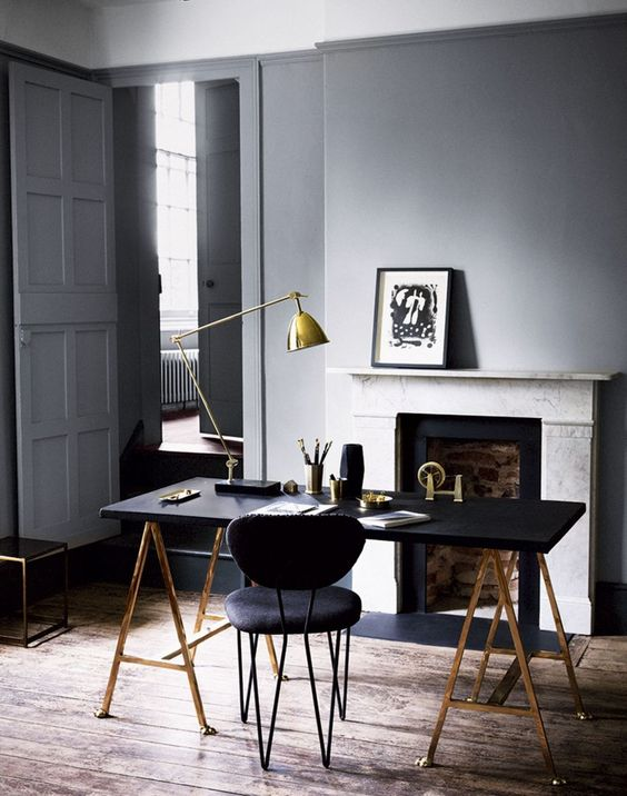 a brass and black lamp fits a mid-century modern manly office