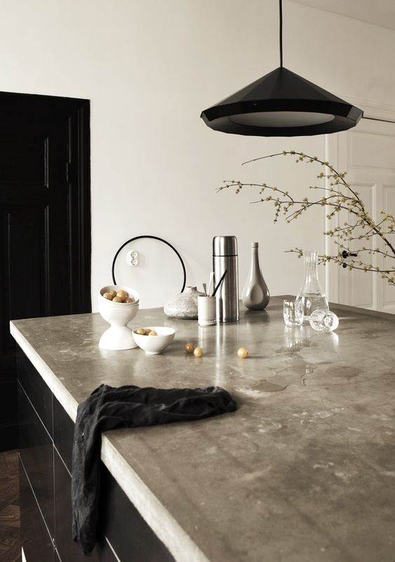 concrete countertop kitchen island in black for a manly space