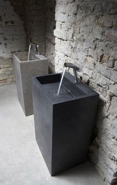 concrete square sinks with nickel faucets look laconic and manly