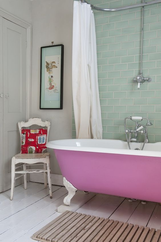painted pink tub on white legs for a cute feminine bathroom