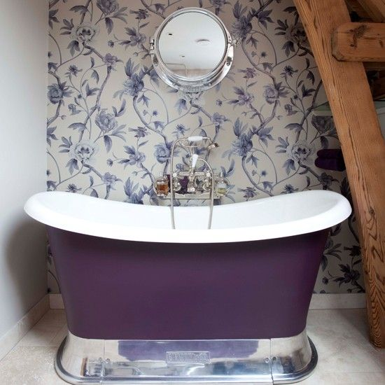a small purple girlish tub on a polished metal stand