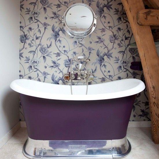 a small purple girlish tub on a polished metal stand