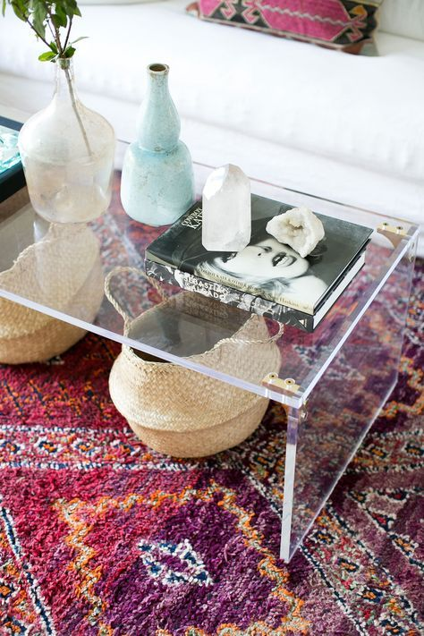 lucite coffee table with brass elements for a chic modern look