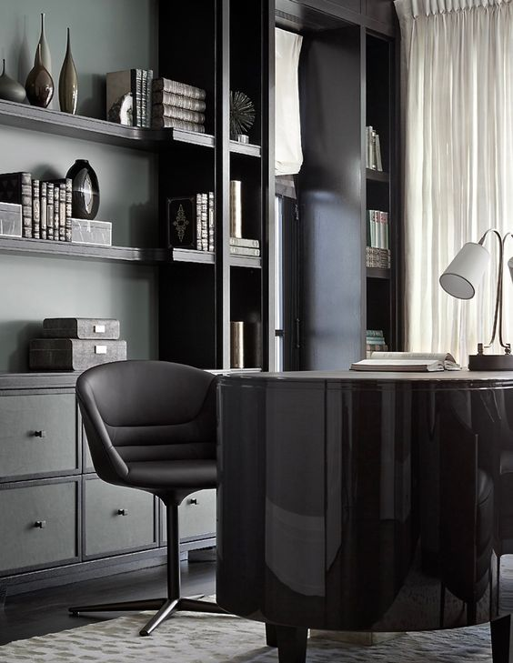 moody office design with open shelving and some drawers for a neat look