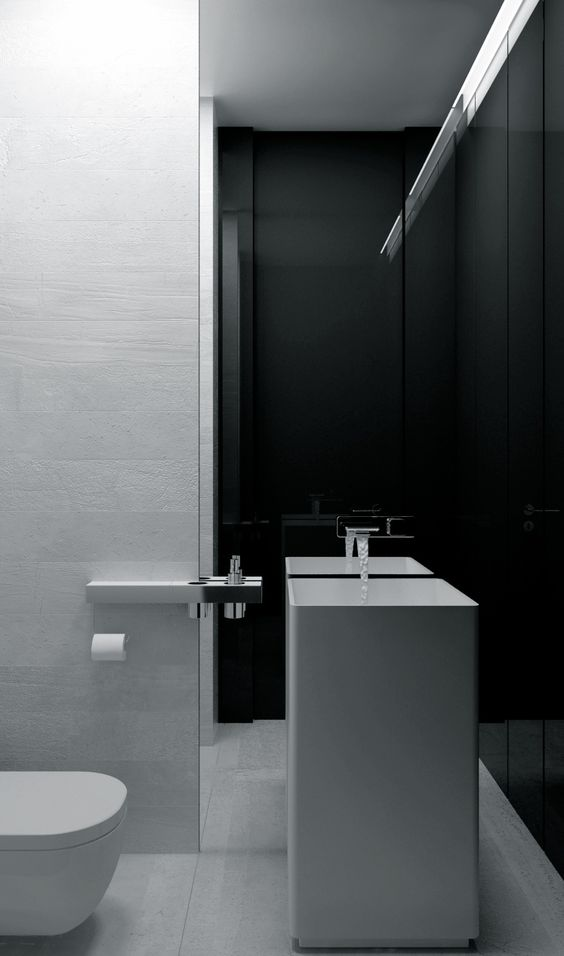 a minimalist black and white bathroom with a square sink