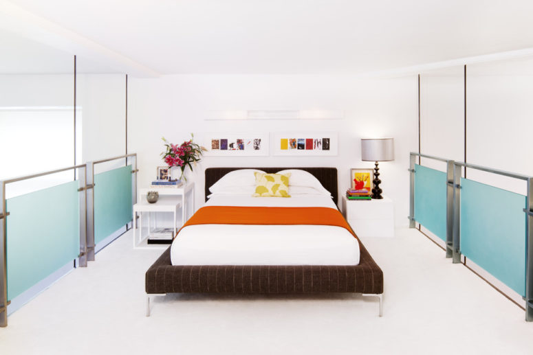 a modern bedroom with a white dresser and a couple of coffee tables