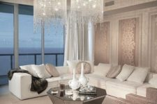 23 a modern living space with a corner sofa and long crystal chandliers with cascading crystals