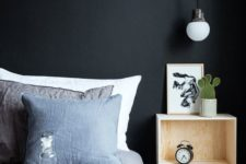 23 an industrial metal covered bulb  completes the bedroom decor