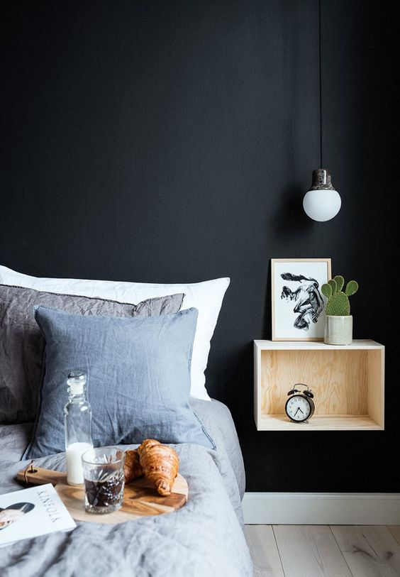 an industrial metal covered bulb  completes the bedroom decor