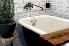 24 Scandinavian space with a black clawfoot tub and a black pot to pull it off