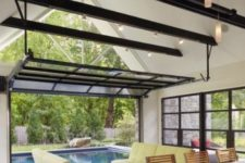24 glass garage doors for opening out to the screen porch