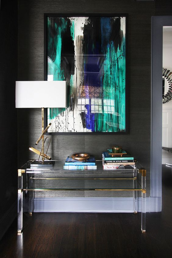 lucite and brass console table with a storage space looks almost invisible