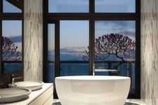 24 luxury bathroom with marble tiles and a gorgeous view from the tub