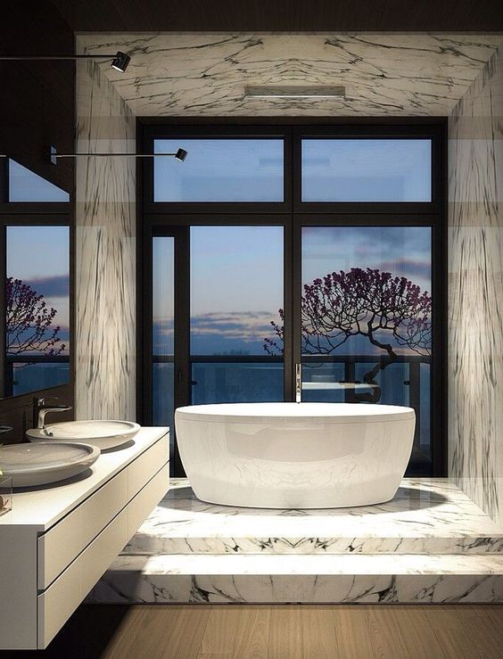 luxury bathroom with marble tiles and a gorgeous view from the tub
