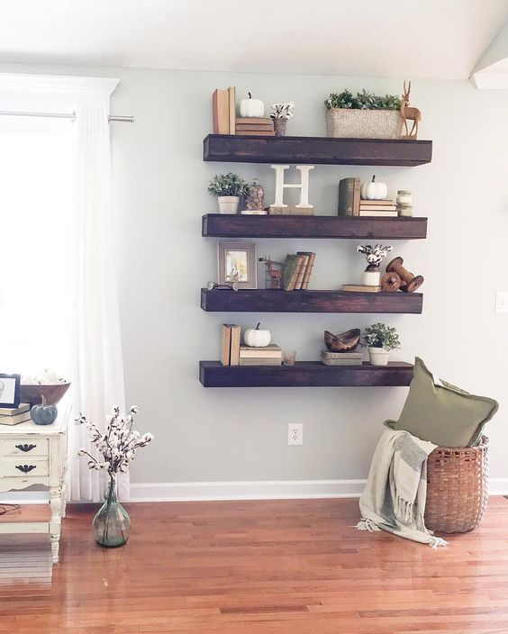 thick dark stained wood shelves make a statement in a light-colored space