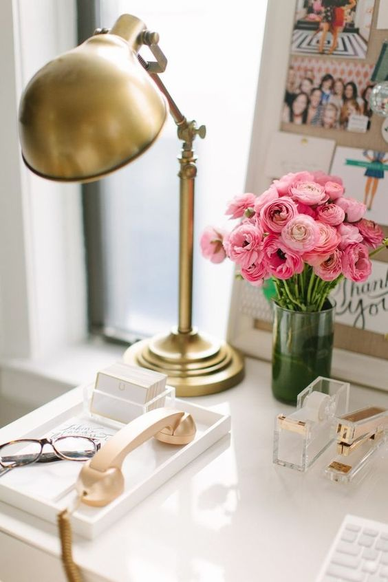 a brass vintage table lamp adds a glam feel to the workspace