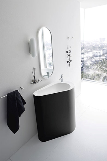 a monolith black and white bathroom sink looks fresh and unusual yet timeless