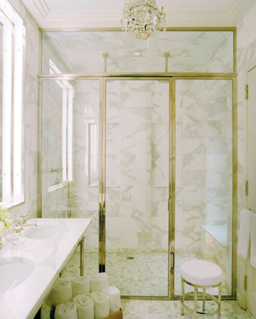 a timeless combo of white marble and gilded framing