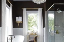 25 a vintage-inspired bathroom with a modern glass bubble chandelier that catches an eye