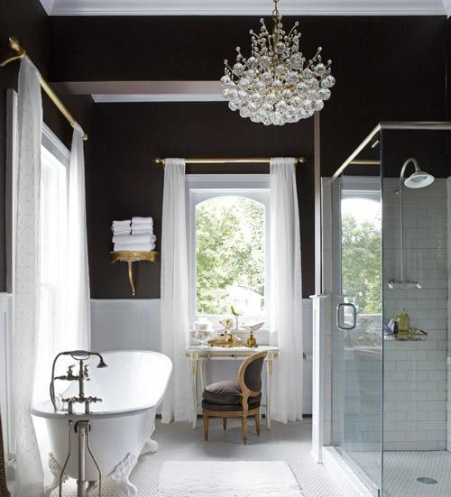 a vintage inspired bathroom with a modern glass bubble chandelier that catches an eye