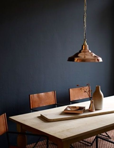 copper pendant lamp and leather chairs in the same shade