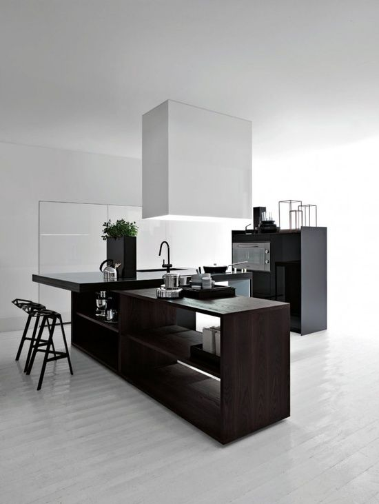 dark stained wooden kitchen island in a black and white kitchen