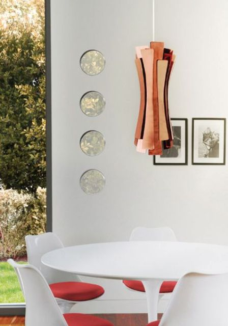 sculptural and geometrical pendant lamp that makes a statement in this space