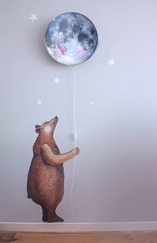 a dreamy sleepy moon wall lamp with a bear sticker for a whimsy look