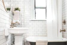26 a soak black clawfoot bathtub on gilded legs in a small retro-inspired bathroom