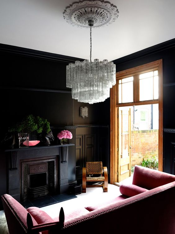 dark and feminine space with a refined statement crystal chandelier