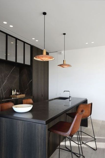 dark wood kitchen island and ocher leather chairs