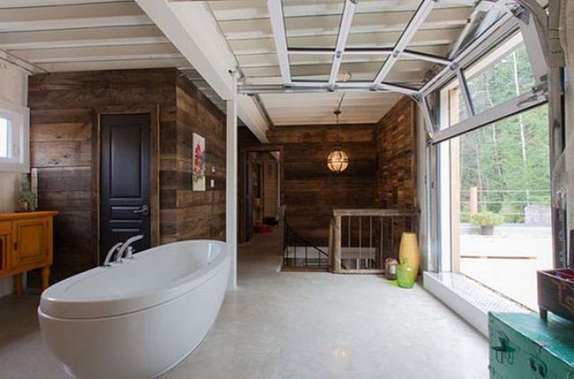 glass garage door opens the bathroom to outdoors perfectly