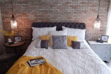 26 industrial blackened metal pendant lamps look nice with a brick wall
