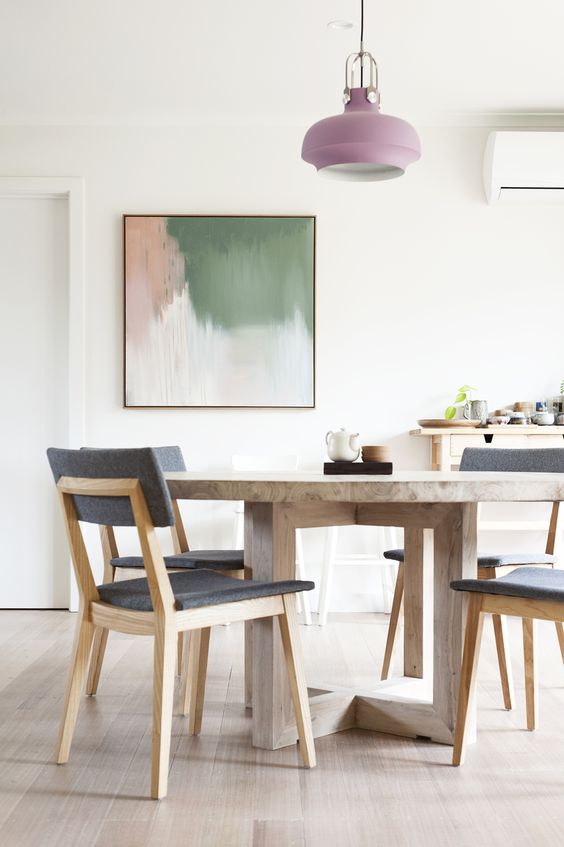 lavender-colored pendant lamp makes this space feminine