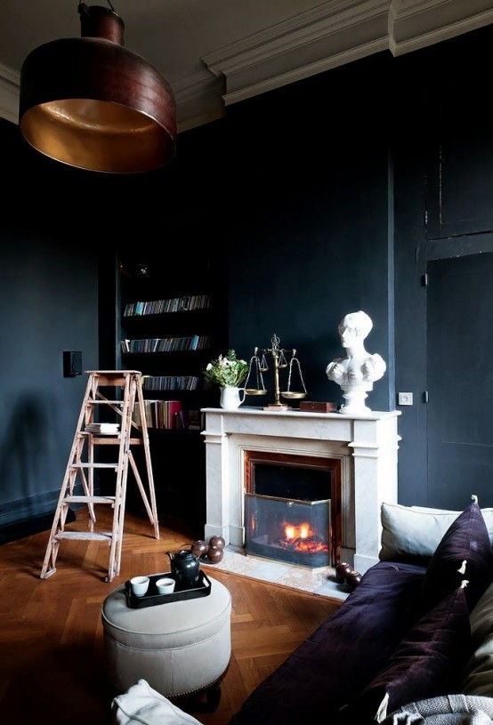 oversized dark metal pendant lamp in a moody space