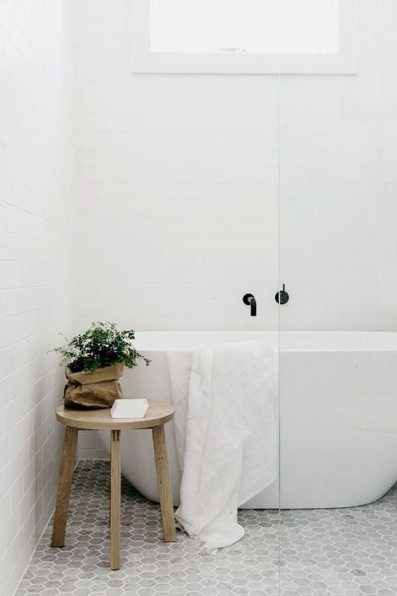 small home spa with marble hexagon tiles and a tub in the shower zone