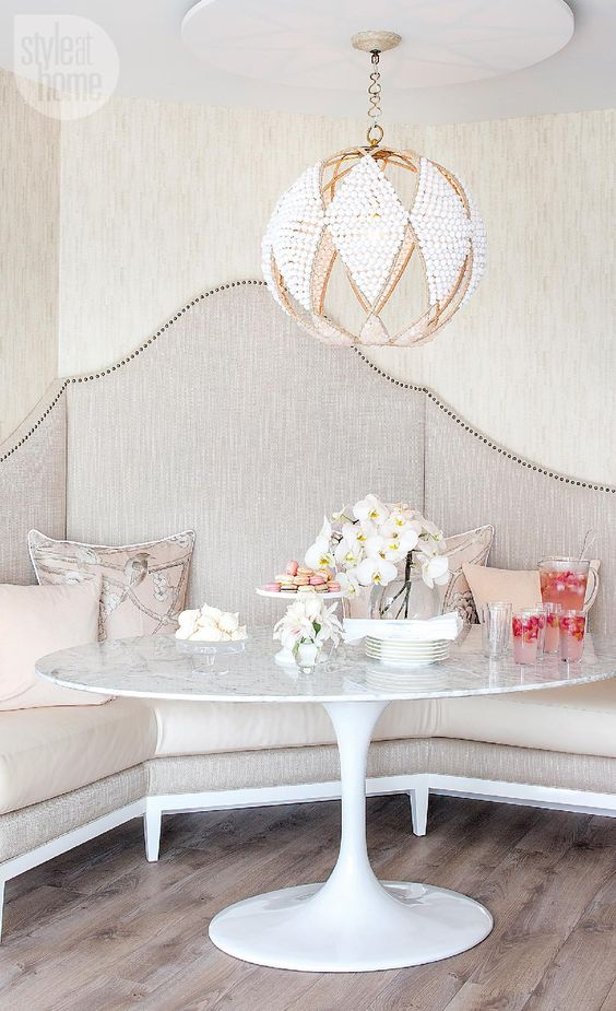 a gorgeous crystal and gold chandelier completes this refined space