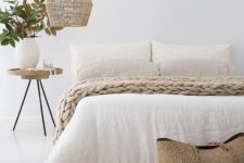 27 a wicker lampshade is ideal for a beach cottage bedroom