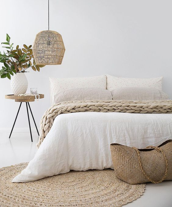 a wicker lampshade is ideal for a beach cottage bedroom