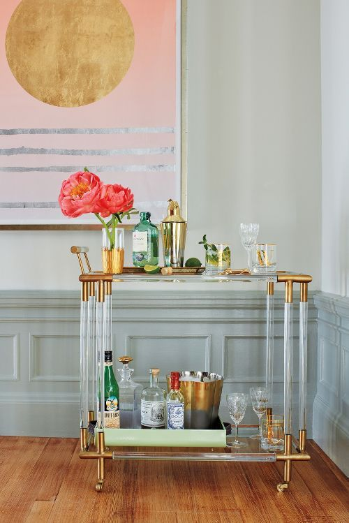 lucite bar cart with gilded elements looks super elegant