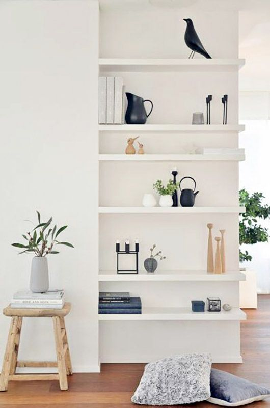 these white floating shelves look lightweight and perfectly fit a modern space