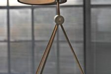 28 a comfy table lamp on three legs with a black concrete and metal lampshade