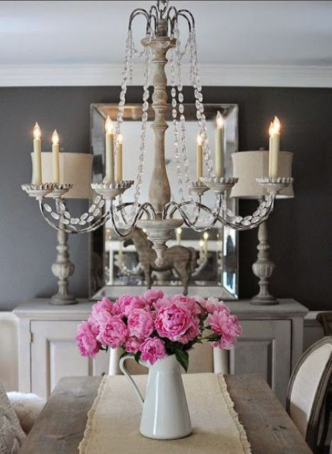 a refined vintage chandelier with crystals and faux candles