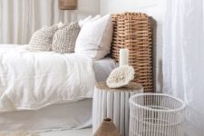 28 a wicker pendant lamp echoes with the same headboard and accessories
